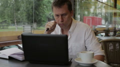 A man very nervous looking at the laptop, and then rejoicing and relief reclines Stock Footage