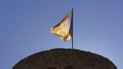 Catalan flag on the tower of castle in Tossa de Mar, Costa Brava Stock Footage