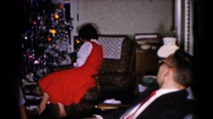 1959: christmas scene mother cheered indoor party presents many HAGERSTOWN Stock Footage