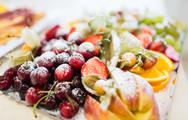 Close up of dish with sugared fruit dessert Stock Photos