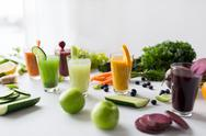 Glasses with different fruit or vegetable juices Stock Photos