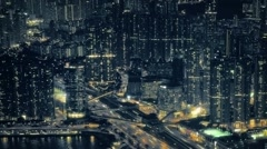 Crowded Cityscape with Dramatic Lighting and Highway Traffic at Night Stock Footage