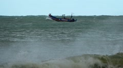 Small Fishing Boat on Rough Seas in Vietnam Stock Footage