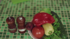 Summer vegetables. Tomatoes and garlic. Peppers. Fresh vegetables. woman hand Stock Footage