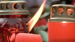 Lit red candle Stock Footage