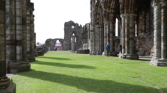 Tourists visiting the ruins of Whitby Abbey Stock Footage