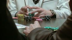Playing poker at a wooden table Stock Footage