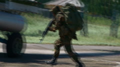 Russian armed soldiers ran to the helicopter. Stock Footage