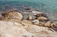 Seascape and rocks shore, beautiful turquoise sea on the summer day. Stock Photos