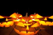 Halloween pumpkins smile and scary eyes for party night Stock Photos