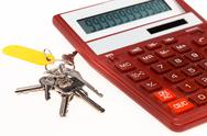 The red calculator with a keys on a white background Stock Photos