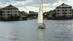 Sailing Boat on the River.  Sailboat floats past Stock Footage