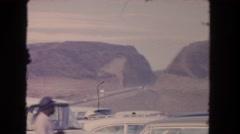1962: desert sand caged outdoor daylight people watch SAN PEDRO, CALIFORNIA Stock Footage