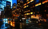 Streets of Manhattan at night Stock Photos