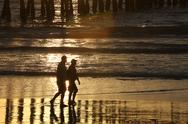 Sunset and pier Stock Photos