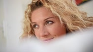 Portrait of blond woman relaxing in the morning Stock Footage
