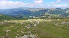 Aerial flight over Babele natural monument on Bucegi plateau, Romania Stock Footage