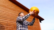 Handsome man play with pumpkin throw it high and catch, slow motion Stock Footage