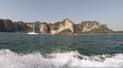 Cruising Past Limestone Seacliffs in Thailand from an Onboard Perspective Stock Footage