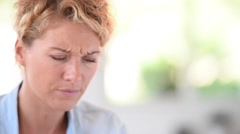 Woman taking aspirine to ease headache Stock Footage