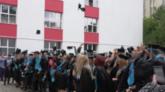 BUCHAREST,ROMANIA,.Blurred image of students throwing hats in the air. Stock Footage