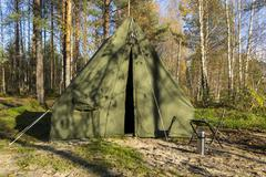 Oldschool tent in forest camp Stock Photos