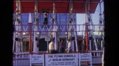 1962: people riding a thrilling ride at an amusement park SAN PEDRO, CALIFORNIA Stock Footage