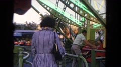 1962: roller coasters and park family is having fun SAN PEDRO, CALIFORNIA Stock Footage