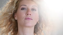Portrait of attractive woman with long curly hair, isolated Stock Footage