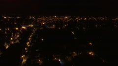 Aerial flight over city at night Stock Footage
