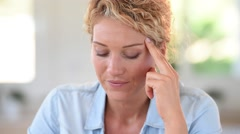 Woman at work taking pill to ease headache Stock Footage