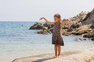 Portrait of Little girl on the sandy beach. Summer vacation. Stock Photos