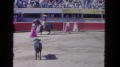 1962: angry bull hitting a horse with a rider in the ground SAN PEDRO Stock Footage