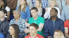 4K Excited fans in sports crowd, celebrating & cheering on their team Stock Footage