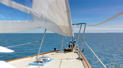 4K Serene Horizon View of Sailboat Sailing, Wind in Sales and Blue Sky and Ocean Stock Footage