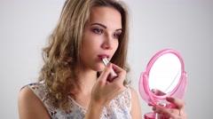 Young woman applying lipstick Arkistovideo