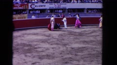 1962: audience provoking a defeated bull after the fight SAN PEDRO, CALIFORNIA Stock Footage