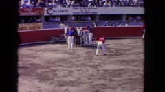 1962: horses pulling an unconscious bull at a rodeo SAN PEDRO, CALIFORNIA Stock Footage