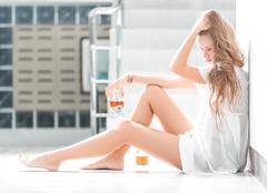 Girl in depression drinking alcohol in solitude Stock Photos