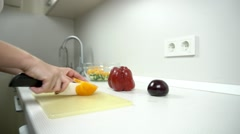 Cooking - cutting yellow tomato in white kitchen into the salad Stock Footage