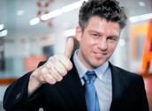 Happy handsome business man holding thumbs up Stock Photos
