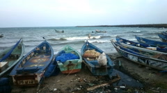 Beach of Indian ocean. Fishing boats waiting out at sea Stock Footage