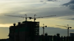 Silhouette of Construction crane with sunrise sky, Timelapse Stock Footage
