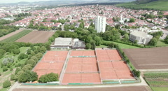 Areal Shot from provincial town to tennis court. Stock Footage