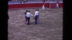 1962: men in the center of a bullfighting ring and a bullfight SAN PEDRO Stock Footage