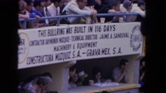 1962: a large group of people watching from the stands at a bullring SAN PEDRO Stock Footage