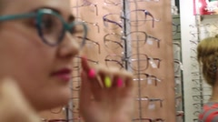 Girl trying on glasses Stock Footage