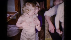 1959: indoor party drinks talk dressed enjoyment family father daughter Stock Footage