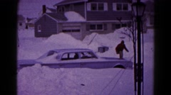 1959: three men are trying to get a car unstuck from a snow drift one man falls Stock Footage