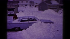 1959: man plows his way through a rigorous snow storm in his car. HAGERSTOWN Stock Footage